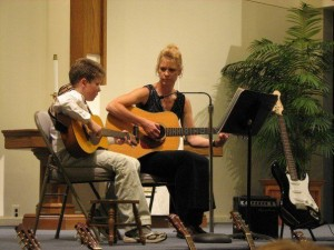 Laurie Teaching Guitar